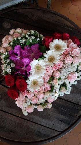 Fleurs deuil enterrement la Sentinelle